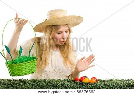 Girl finds a easter egg in the green grass.