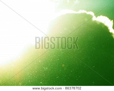 Abstract Green Background With Floating Dust