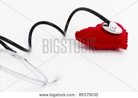 Doctor's Stethoscope Listening To A Healthy Red Heart