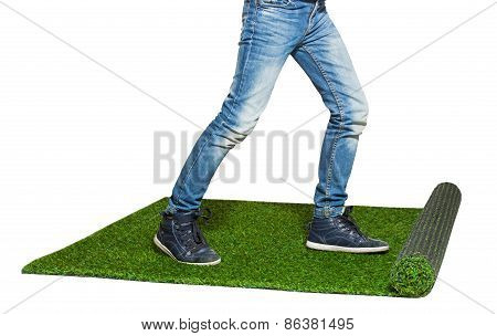 Child Legs Walking On Artificial Grass Isolated On White