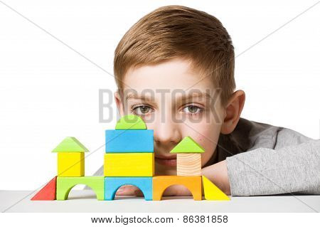 Portrait Of A Boy With House Made Of Wooden Blocks
