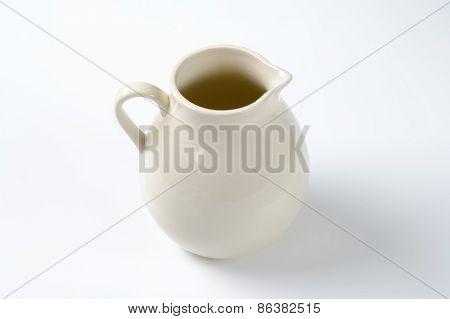 empty milk jug on white background