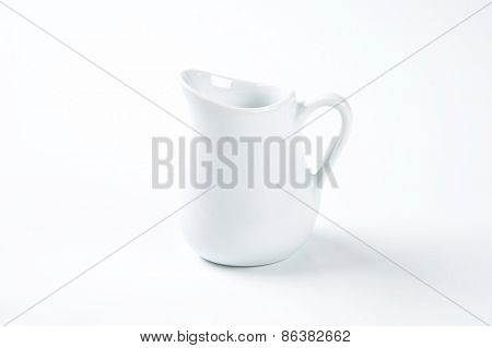 white milk jug on white background