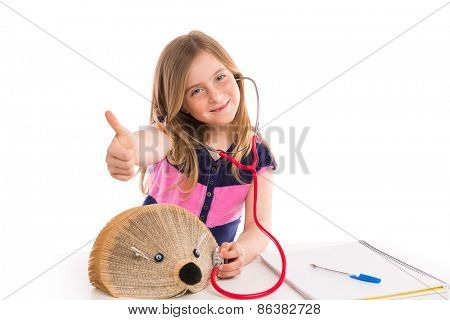Blond kid girl pretending be a doctor with hedgehog book on white background