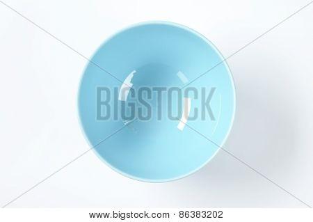 empty blue bowl on white background