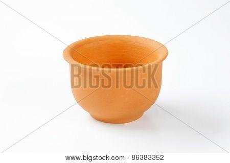 deep orange bowl on white background