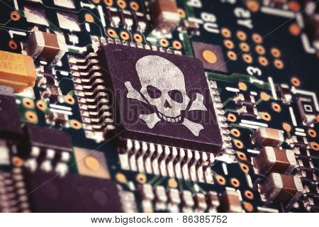 Macro photo of a circuit board with microchip carrying a pirate symbol