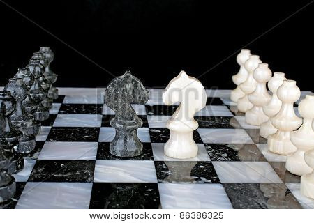 White Knight vs. Black Knight on a marble chess board