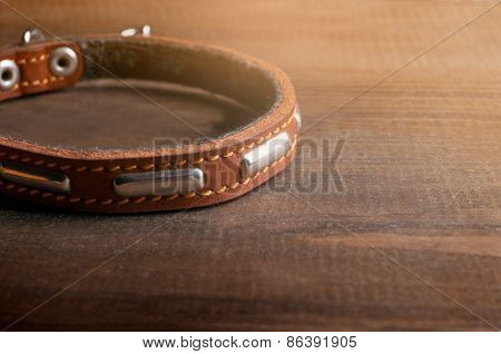 Dog Collar On The Wooden Table