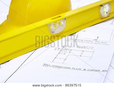 Blueprints With Hard Hat And Level