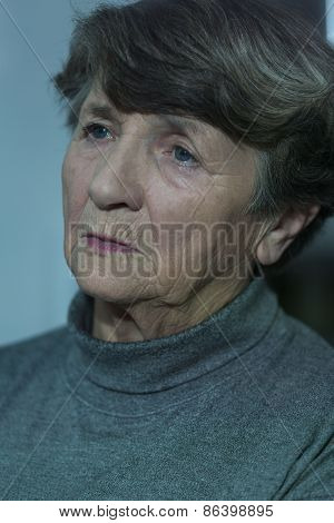 Portrait Of Worried Elder Woman