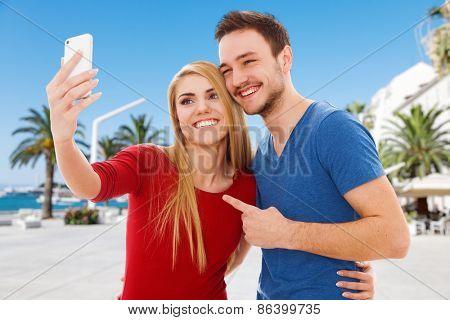 Young beautiful couple making a selfie