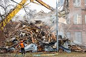 image of school building  - excavator demolishes old soviet school building in moscow