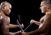 stock photo of filipino  - two muscular martial artists sparring on a black background - JPG