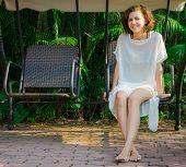 foto of swingset  - Woman sitting on the swingset - JPG