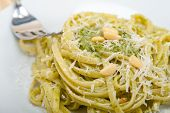 image of pine nut  - Italian traditional basil pesto pasta ingredients parmesan cheese pine nuts extra virgin olive oil garlic on a rustic table - JPG