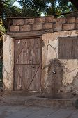 picture of saudi arabia  - Old house with wooden door Saudi Arabia - JPG