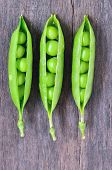 image of green pea  - Green peas on wooden background, close up ** Note: Shallow depth of field - JPG