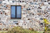 image of stone house  - stone wall with window - JPG