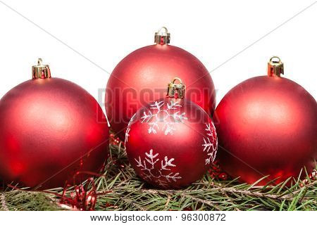 Red Christmas Baubles On Green Spruce Tree Branch