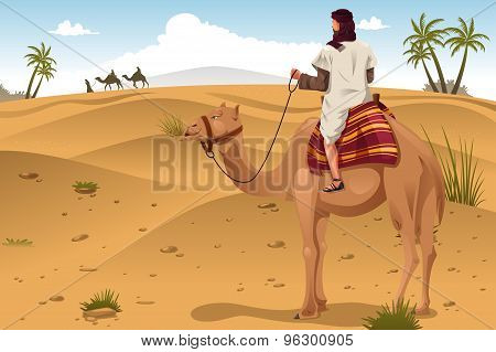 Arabian Riding Camels On The Desert