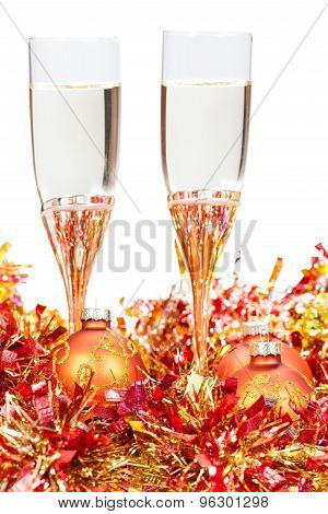 Glasses Of Champagne At Yellow Xmas Decorations