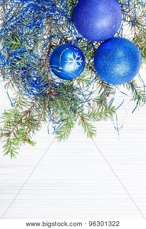 Three Blue And Violet Xmas Balls And Twig On Paper