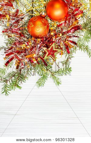 Star And Two Orange Xmas Baubles And Twig On Paper