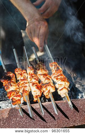 Man Cooks Kebabs On Grill