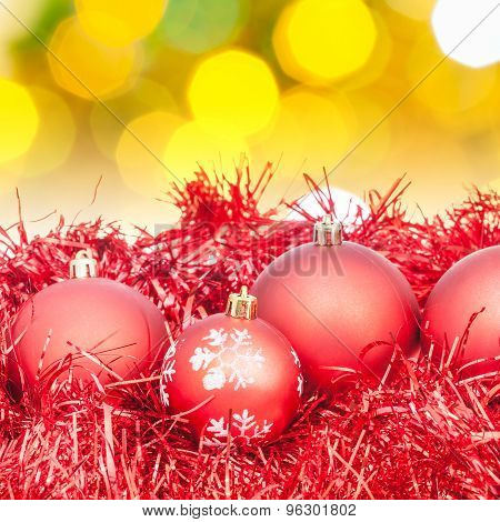 Xmas Red Balls On Blurred Yellow Green Background