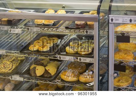 A lot off choice of pastry in cafeteria