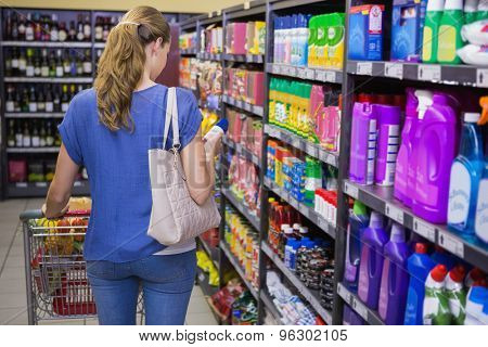 Rear view of woman doing shopping in supermarket