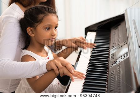 Helping To Play The Piano