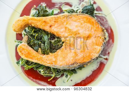 Grilled Salmon Steak with Spinach