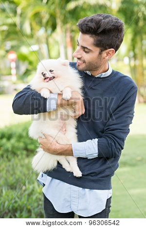 Holding Little Dog