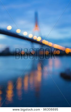 Twilight of Suspension Bridge with water reflection, abstract blur bokeh background