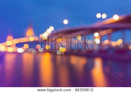 Abstract blurred bokeh lights of suspension bridge and highway curved