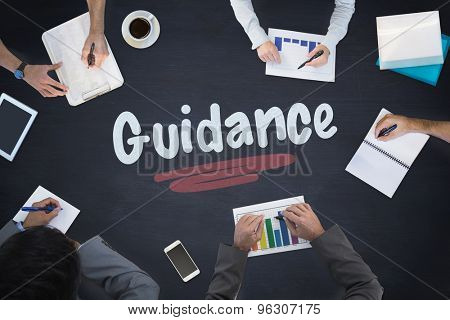 The word guidance and business meeting against blackboard