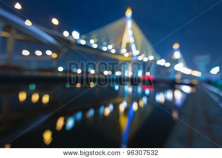 Out of focus bokeh lights Bangkok suspension bridge