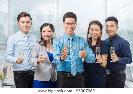 Cheerful Asian Business Team