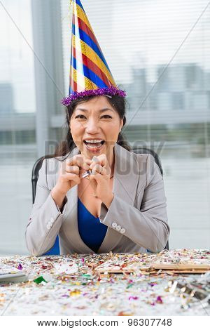 Business Woman In A Party Hat