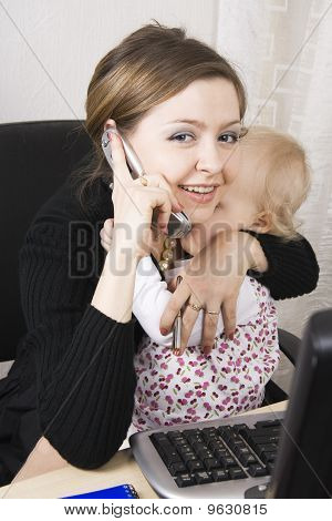 Busy Mother With Her Baby