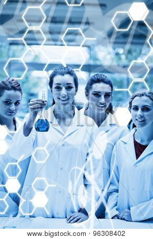 Science graphic against portrait of lab partners posing with a flask