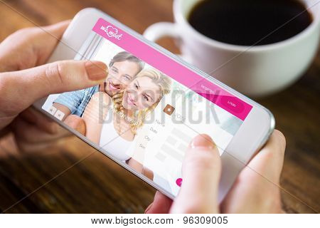 Woman using smartphone against dating website