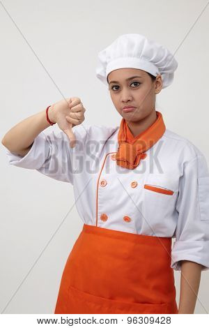 woman chef sad expression with thumb down