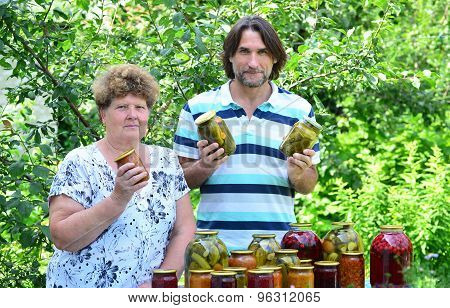 woman and her son at the table with canned vegetables