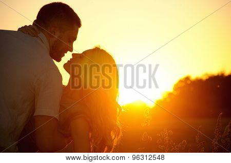 Romantic Sensual Young Couple In Love Kissing At The Sunset