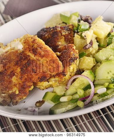 Chicken Schnitzel With Potato Salad And Cucumbers