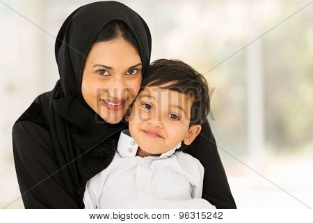 portrait of pretty muslim woman with her son