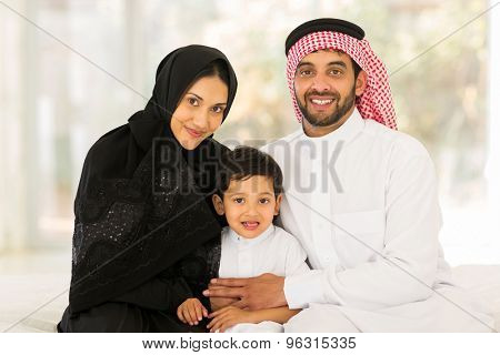 adorable muslim family sitting at home